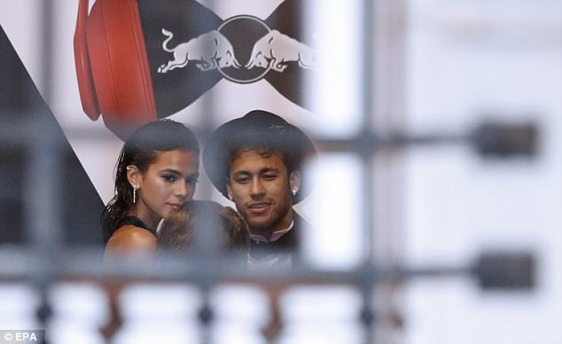 Neymar and girlfriend Bruna Marquezine chat to a guest before heading inside the venue