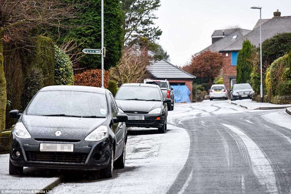 Residents in Saddleworth, Greater Manchester had to clear snow from their cars ahead of the Monday morning commute