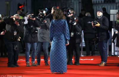 Work it! Rachel accessorised with a simple boxy clutch as she posed up a storm on the red carpet