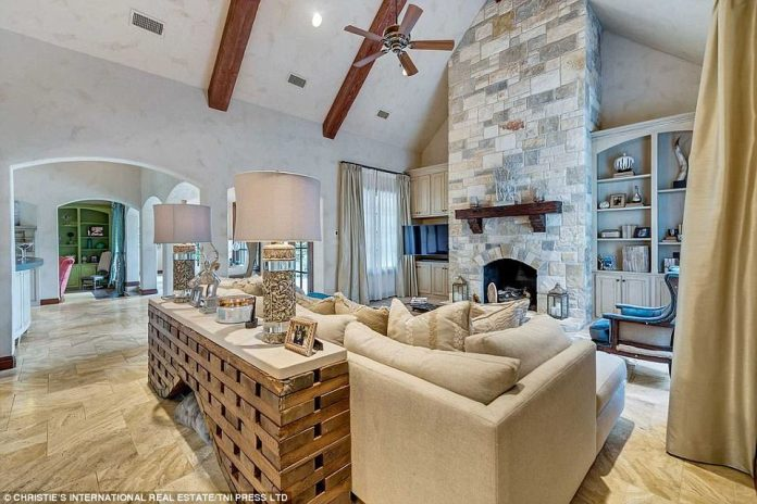 Sight to behold: The singer's living room is a sight to behold, thanks to its dramatic vaulted ceiling and stylish stone fireplace