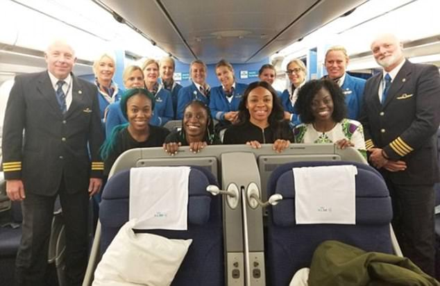 On our way: The Nigerian bobsleigh and skeleton team pose for a photo with the flight crew during their journey to South Korea