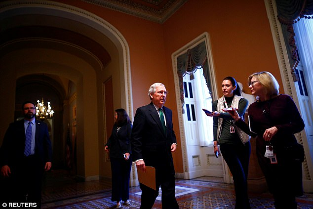 Senate Majority Leader Mitch McConnell walks to the Senate chamber on Capitol Hill in Washington, U.S. February 7, 2018