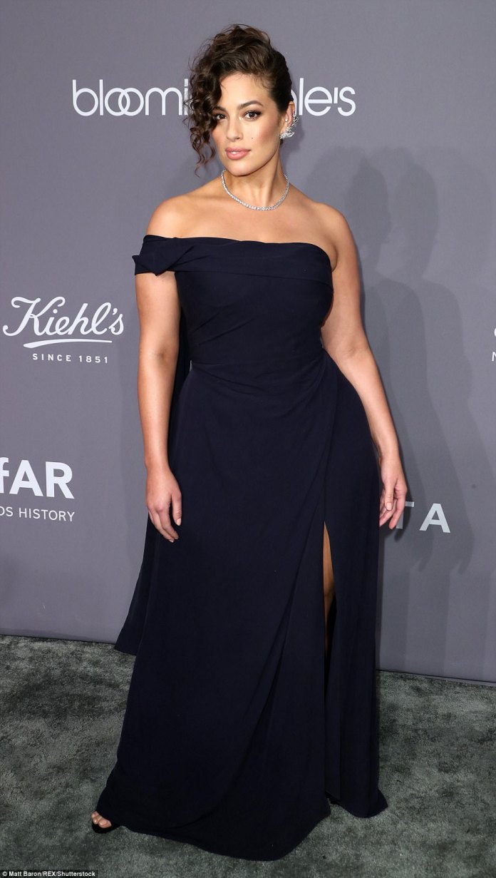 Plus-size model Ashley, 30, wore a classy off-the-shoulder black gown with one sleeve. It was gathered at the waist and had a slit on the left side