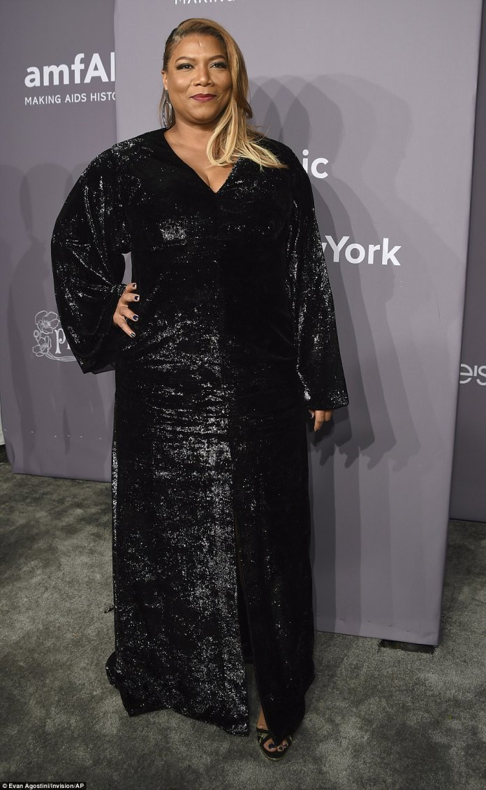 Queen Latifah, 47, supported the fundraising  gala in a shimmery black gown with long wide sleeves and a split at the front