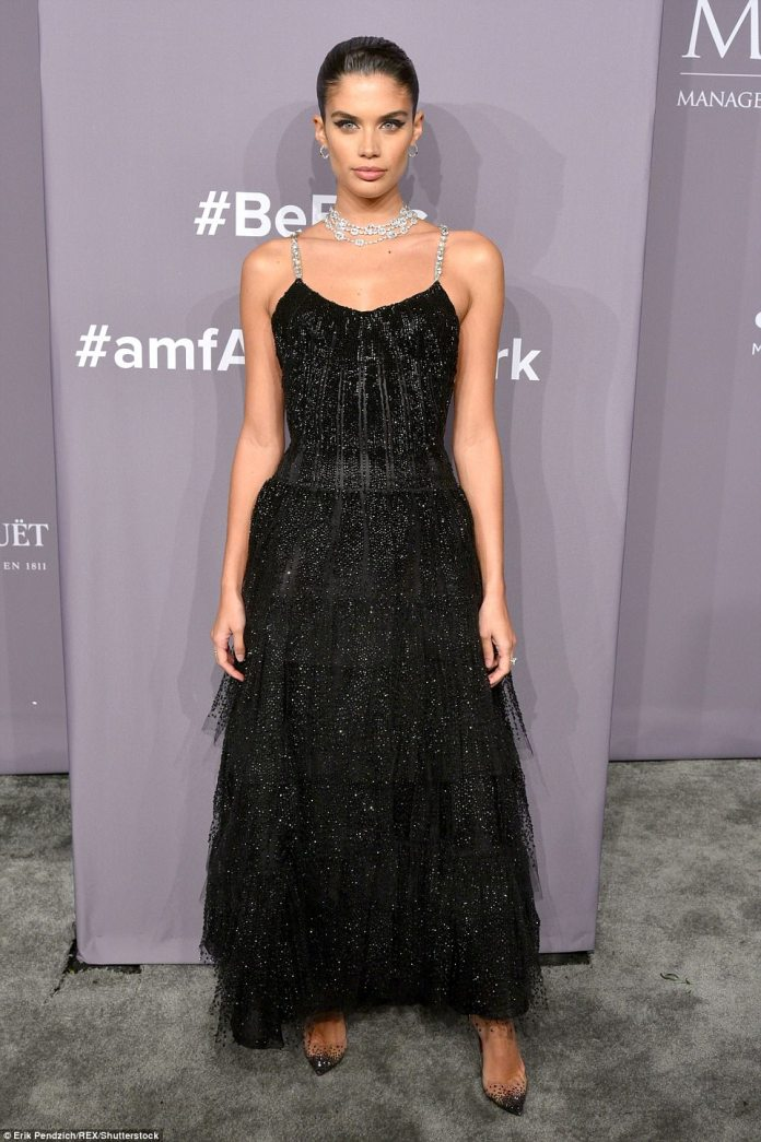 Victioria's Secret Angel Sara Sampaio, 26, looked gorgeous in  a strapless dress with a tight bodice with silver straps and a floaty ankle-length skirt
