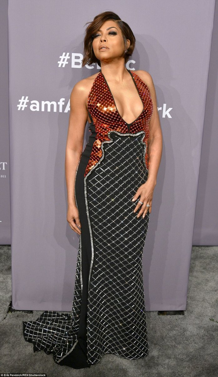 Empire star Taraji, 47, flaunted her assets in a metallic red, black and silver gown. The sleeveless dress had a halter neck and pooled around her feet with a small train