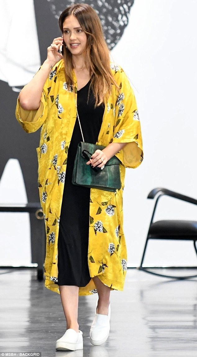 Mommy wears! Jessica Alba looked like a ray of sunshine in her yellow floral Kimono