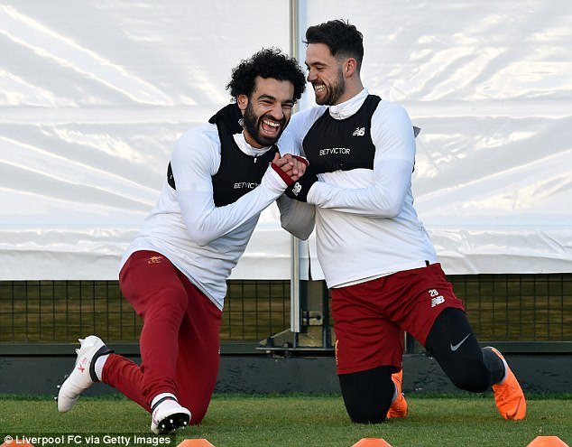 Mohamed Salah (left) and Danny Ings shared a joke during Liverpool's training session