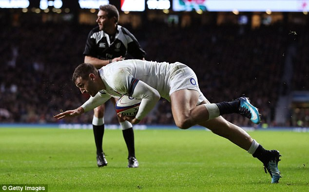 May dives to scores his and England's second try of the game at Twickenham on Saturday
