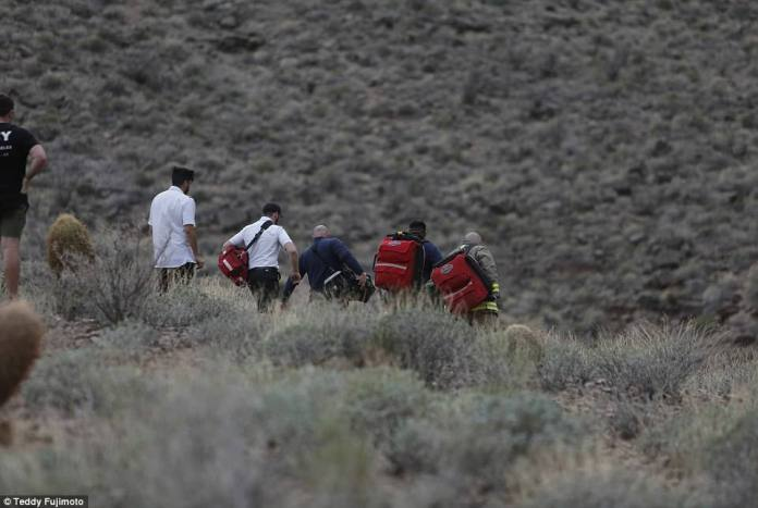 Witnesses rushed to the scene of the accident when it occurred, but they victims were 600ft or further below them (Pictured, rescuers arrive)