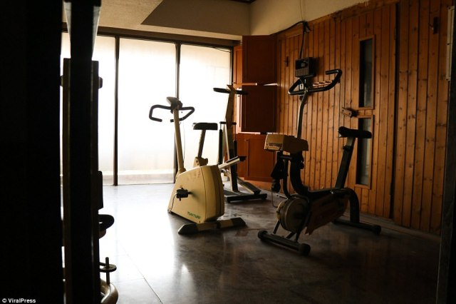 Disused exercise equipment sits alongside the old sauna in one room of Ocean Massage, which was abandoned in January