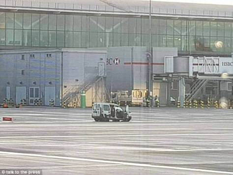 The wreckage of one of the vehicles sits outside Terminal 5 at London Heathrow today