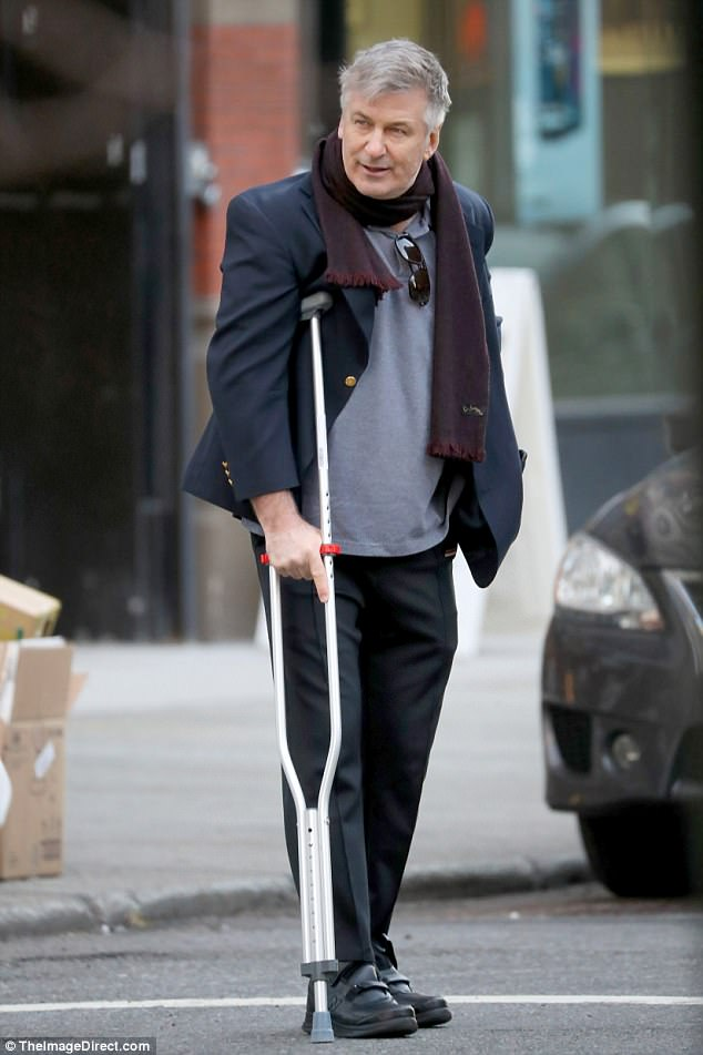 Alec Baldwin Hobbles On Crutches In New York Daily Mail Online