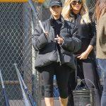 Pregnant Khloe Kardashian Cradles Bump at Softball game with Family