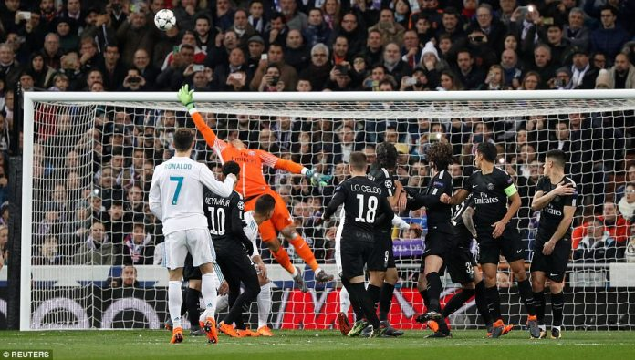 Ronaldo steps up to take a free-kick in a dangerous area but is unable to get it up and down in time to shoot on target