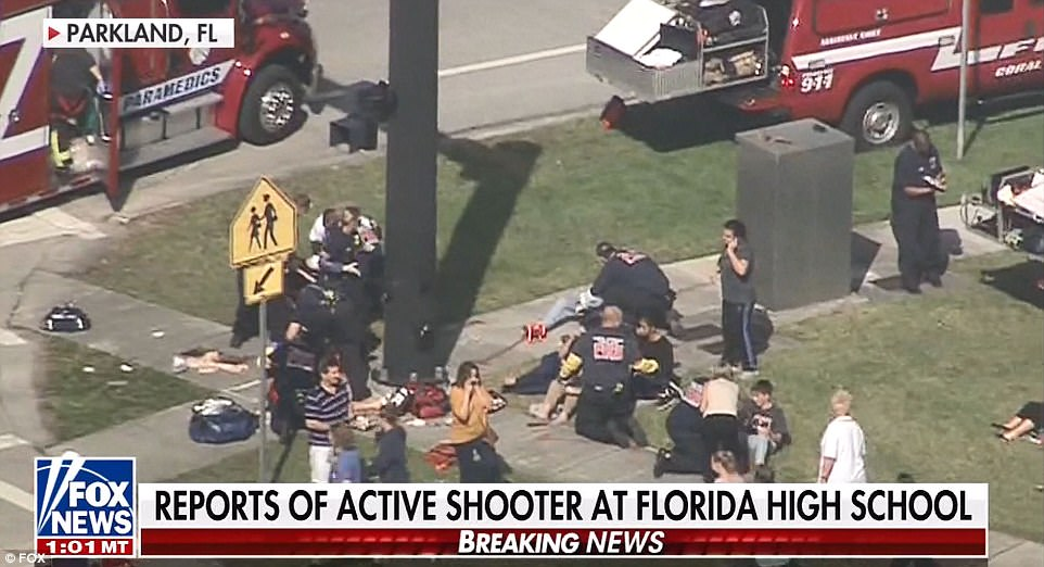 Shocking: Victims of the shooting were being treated on the sidewalk while the gunman was reported to still be at large and law enforcement officers from multiple agencies were flooding the area