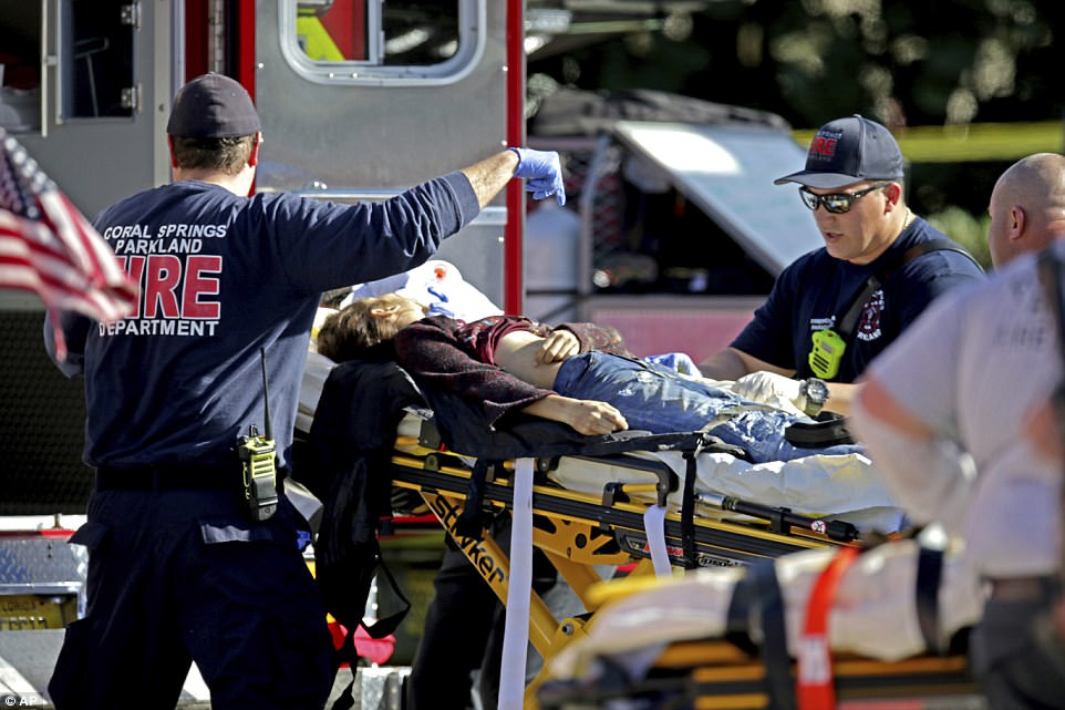 An injured female was transported from the school on a stretcher by first responders on Wednesday afternoon