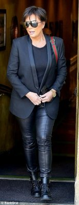 All black: She was sophisticated chic in tight black leggings and a tailored jacket as she rocked retro shades