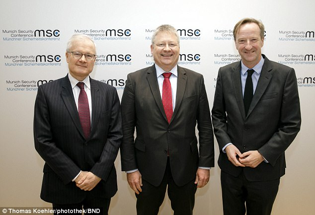 Alex Younger (right), the head of MI6, and his European counterparts Germany's BND President Bruno Kahl (centre) and France's DGSE chief Bernard Ernie (left), met in public for the first time today (pictured) to stress the necessity of their close ties