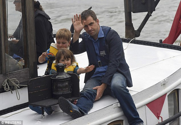 'I think that I've let myself down,' Mr Cox added. 'I need to take responsibility for that. It's what I'm trying to do' (pictured with his sons on the River Thames)