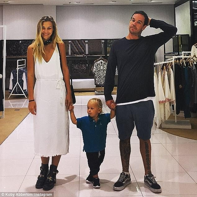 Big wave surfer Koby Abberton pictured with his model wife Olya Nechiporenko and their son