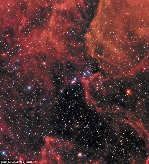 In 1987, astronomers observed a 'Titanic supernova' in a nearby galaxy, blazing with the power of more than 100 million suns (pictured)