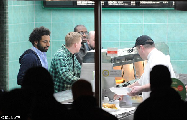 Mohamed Salah enjoyed some fish and chips as he took a break from his football duties