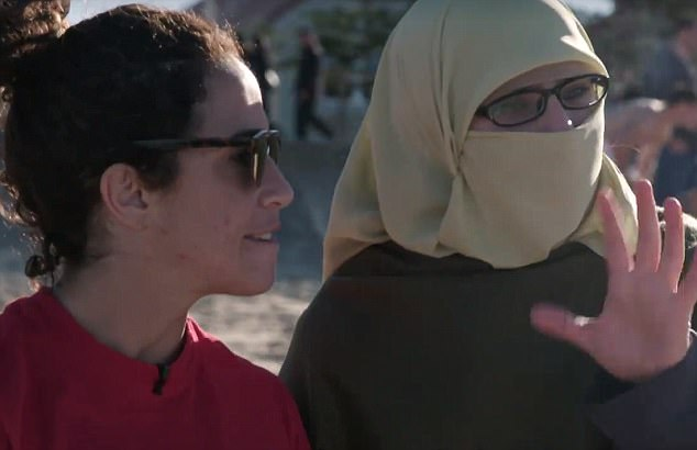 Anjum (pictured, right, with Bianca), a cast member on the show, has an encounter with another woman while sitting on Sydney's Manly Beach dressed in a niqab