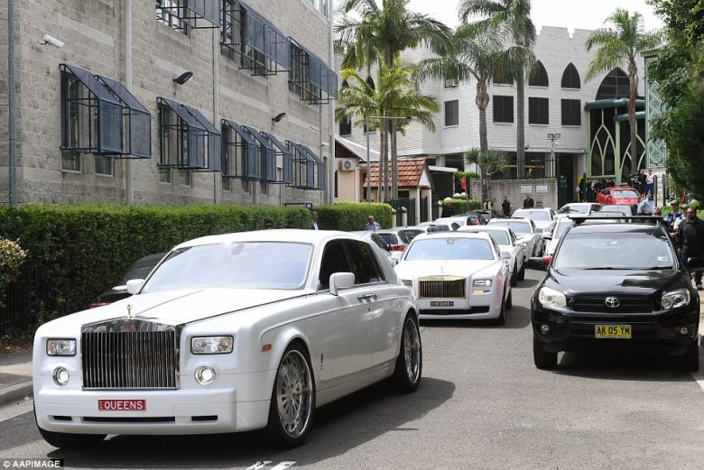 Luxury cars followed the hearse carrying Hawi's body away from the mosque and toward the cemetery