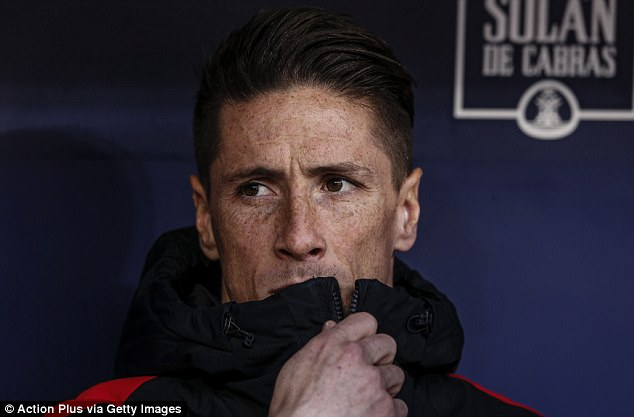 Diego Simeone has cast doubt on Fernando Torres (above) staying at Atletico Madrid