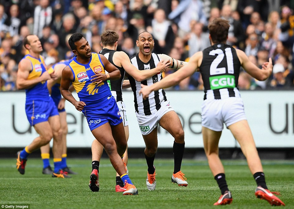 Varcoe celebrates with teammates after scoring the first goal of the AFL Grand Final