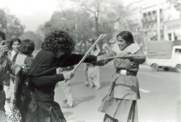 A woman activist of the PPP's student-wing, the PSF, clashes with the police during a rally against Zia's draconian laws (Lahore, 1981).