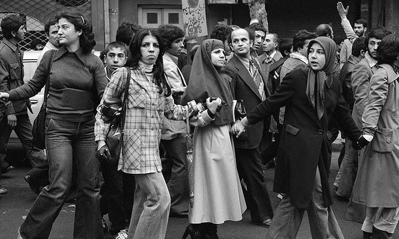 Women members of leftist and Islamic organisations protest together against the Shah of Iran in 1978.