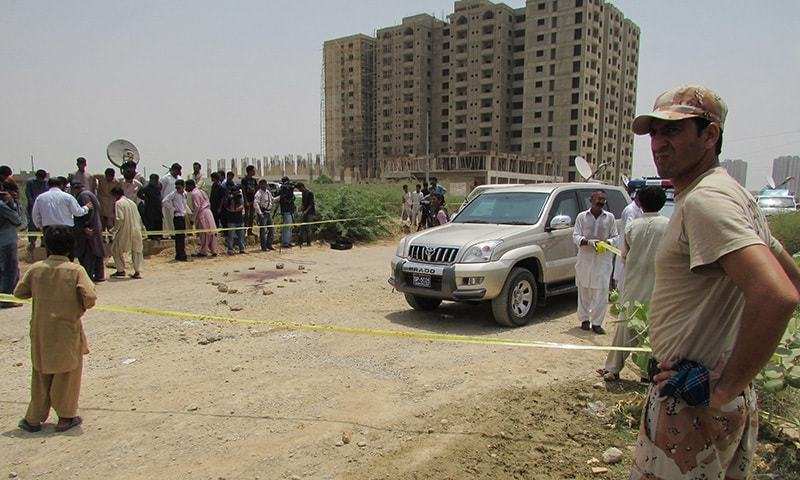 Police cordon off the site of an attack by gunmen in Karachi, Pakistan, Wednesday, May 13, 2015. — AP
