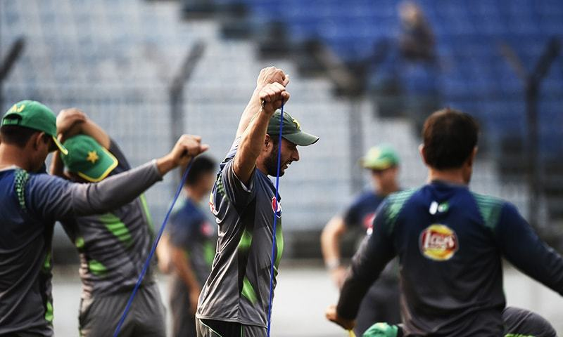 Pakistan captain Shahid Afridi stretches during a training session. — AFP/File