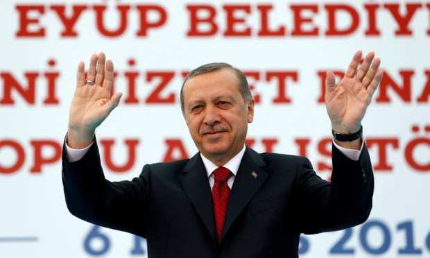 Turkish President Tayyip Erdogan greets his supporters during an opening ceremony in Istanbul. —Reuters