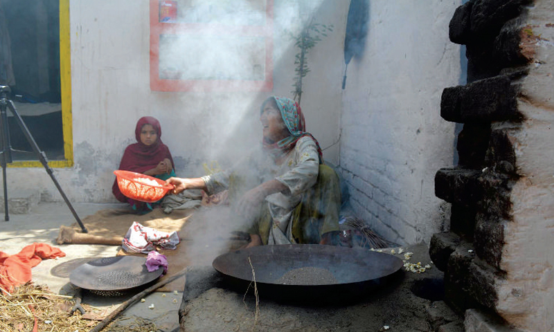 Image result for cooking with firewood, pakistan