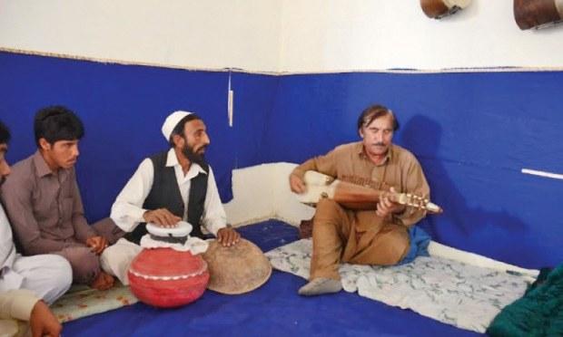 Mutrib Mashukhel plays rabab at his academy in Peshawar. — Dawn