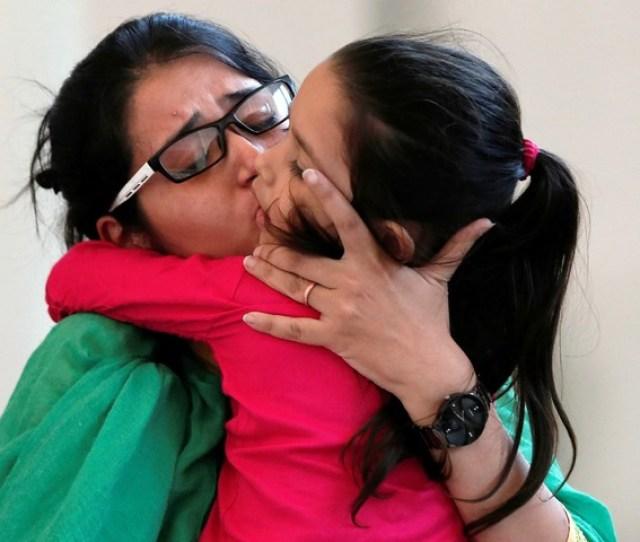Uzma Kisses Her Daughter After Her Arrival In New Delhi Reuters