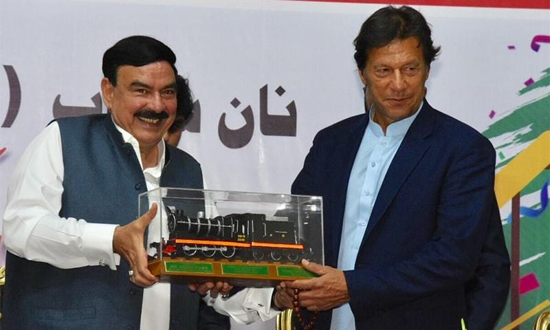 Minister for Railways Sheikh Rashid (L) and Prime Minister Imran Khan at the inauguration of the Lahore-Karachi Jinnah Express in Lahore on March 30. ─ Photo courtesy Sheikh Rashid Twitter