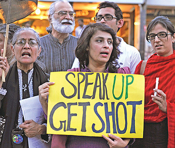 Activists stage a protest against the killing of Rashid Rehman. —Photo by Tanveer Shahzad