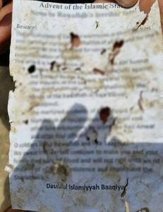 A view of a pamphlet left by the attackers at the scene of attack.