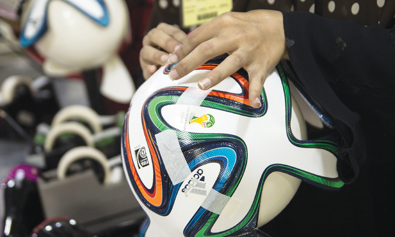 Here, women put together panels for the Brazuca