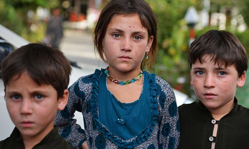 Pakistan children whose families fled North Waziristan tribal region pose for a photograph in Bannu. — Photo by AFP