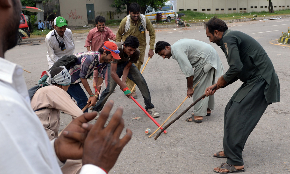 Supporters of Tahirul Qadri and Imran Khan play near the prime minister's residence during an anti-government protest in Islamabad. - Photo by AFP