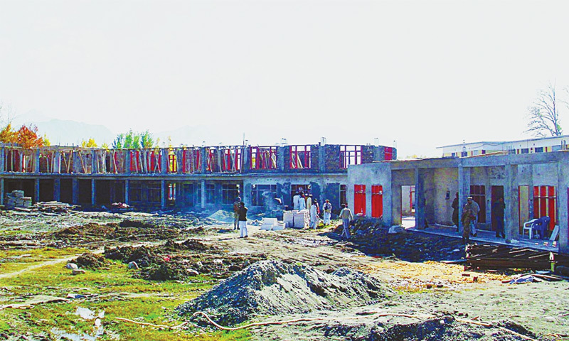 November, 2011: Rebuilding carries apace at the Government Girls Degree College in Kabal,  which was destroyed by Taliban militants.—Online file photo