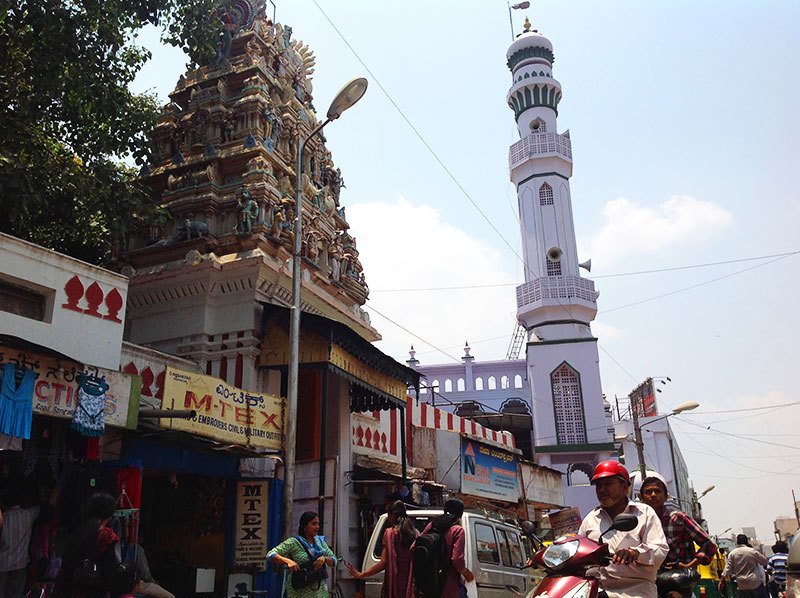 This minaret and spire in a Bangalore bazaar has a multitude of shops at their base, visited by all.