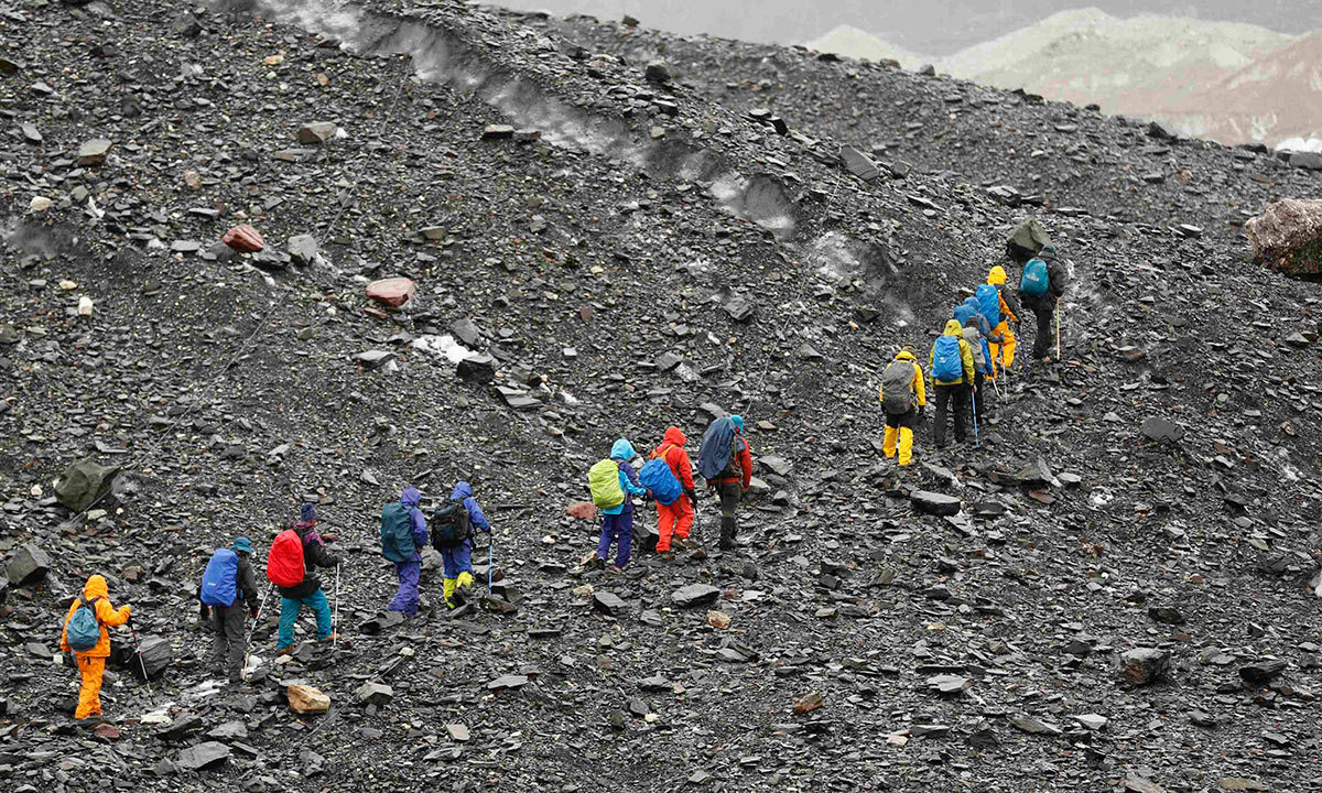 A group of Japanese trekkers climb the rock-covered Baltoro glacier in the Karakoram mountain range. -Reuters Photo