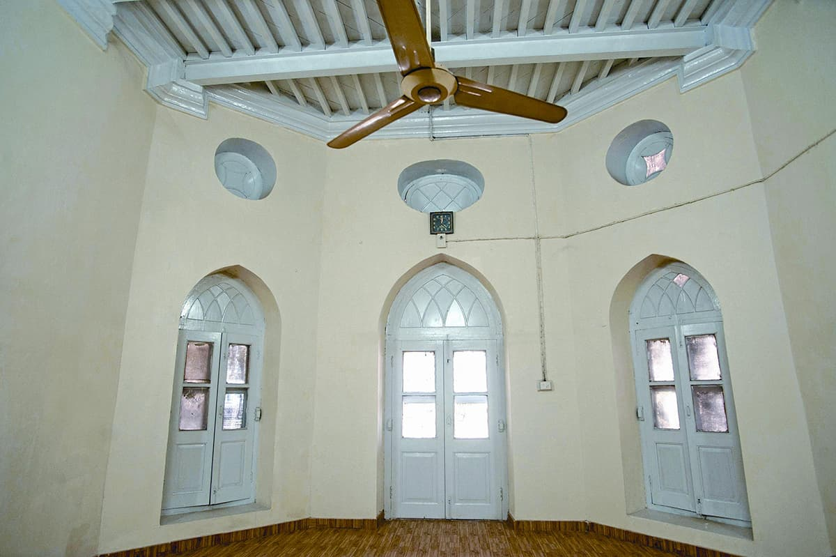 A recently renovated room, with whitewashed walls, is being used as the office of Azad Jammu and Kashmir Properties administrator. This area once served as the durbar of the Maharaja of Kashmir.