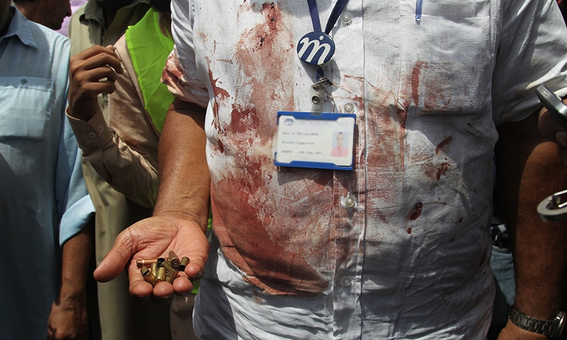 A rescue official displays casings collected from the scene of an attack on a bus, in Karachi, Pakistan, Wednesday, May 13, 2015. — AP